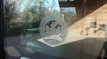 LEED Gold certification on glass door of the Trinity River Audubon Center