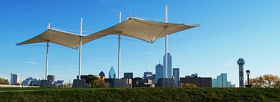 Panoramic view of the Trinity Overlook Park with architectural shade structures. This park gives visitors to the area a closeup view of the Dallas Floodway with signage explaining the proposed Trinity Lakes region